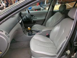 Renault Laguna. Nuotraukos atitinka