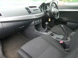 Mitsubishi Lancer. Dalimis