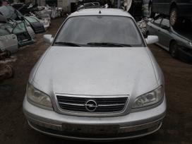 Opel Omega. Dalimis