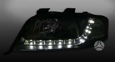 Audi A6. Audi a6 priekiniai tuning žibintai šviesūs arba juodi