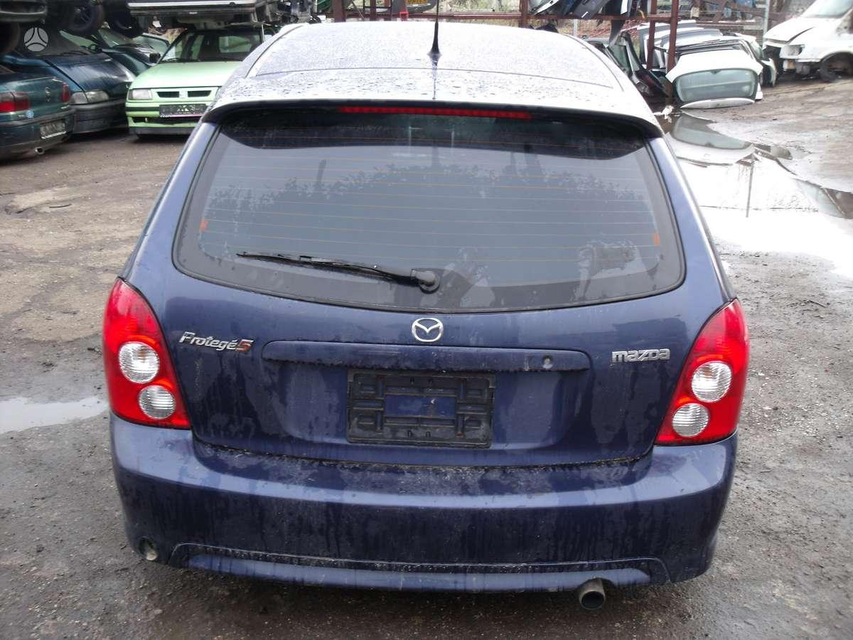 Mazda Protege. Dalimis