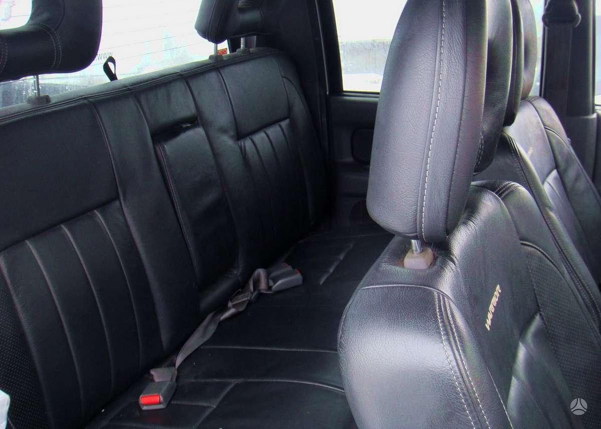 Mitsubishi L200. Odinis salonas  доставка бу запчастей с разтам