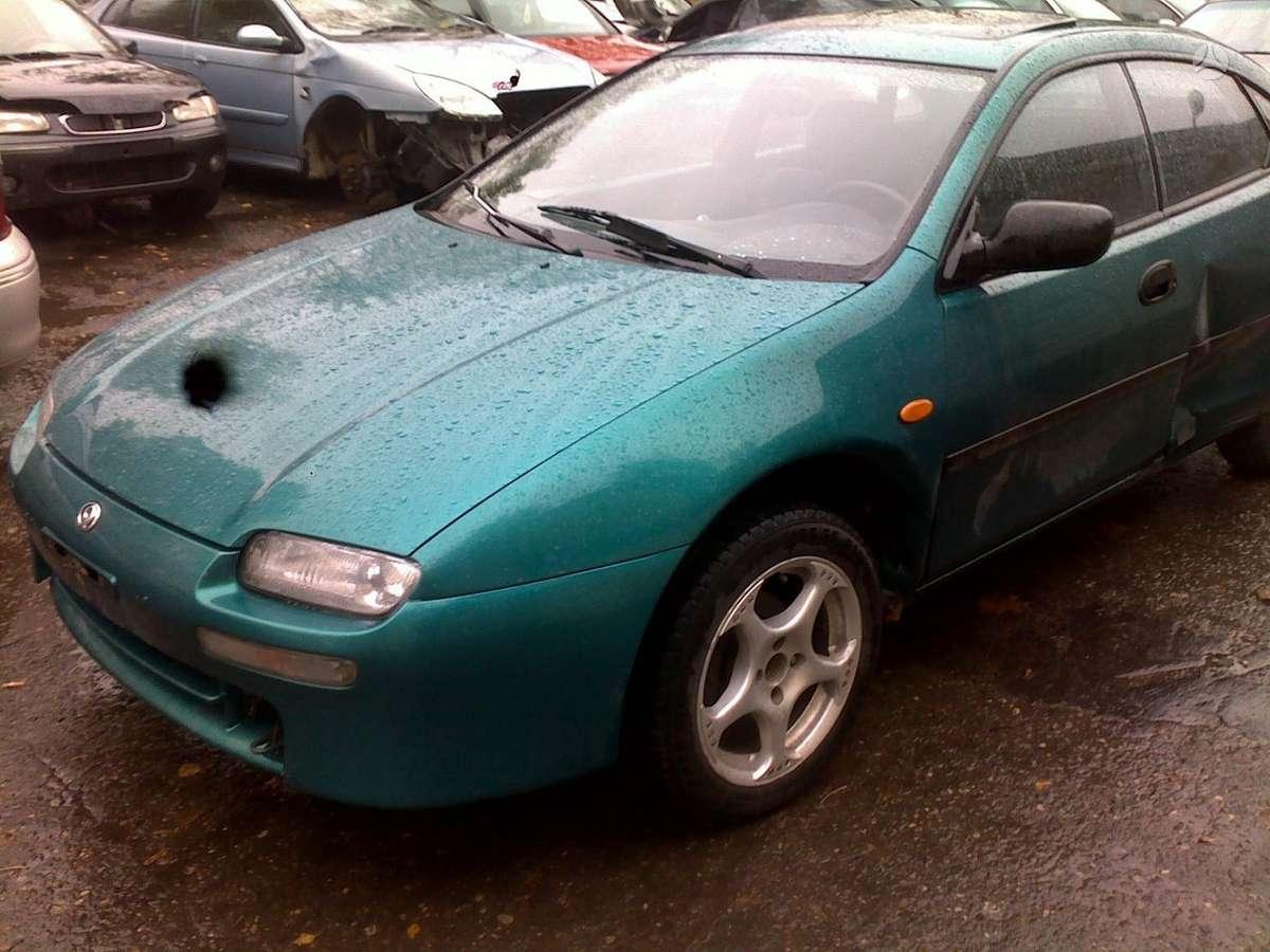 Mazda 323F. Lieti ratlankiai r15, kondicionierius, 2 el. langai.