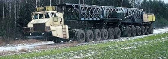 """Baltarusiškas """"šimtaratis"""": vienintelė pasaulyje mašina su 24 varančiaisiais ratais"""